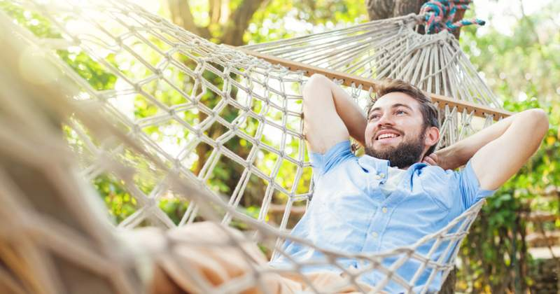 Guy relaxing in hammock